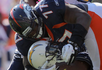 DENVER, CO - OCTOBER 09:  Ryan Mathews #24 of the San Diego Chargers looses his helmet to Brodrick Bunkley #77 of the Denver Broncos at Sports Authority Field at Mile High on October 9, 2011 in Denver, Colorado. The Chargers defeated the Broncos 29-24.  (