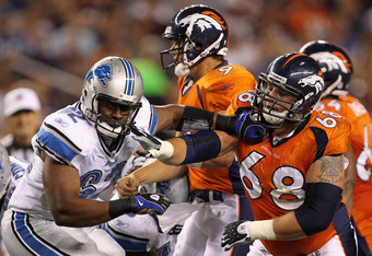 DENVER - AUGUST 21:  Rookie offensive guard Zane Beadles #68 of the Denver Broncos blocks Chima Ihekwoaba of the Detroit Lions as he protects quarterback Brady Quinn #9 during preseason NFL action at INVESCO Field at Mile High on August 21, 2010 in Denver