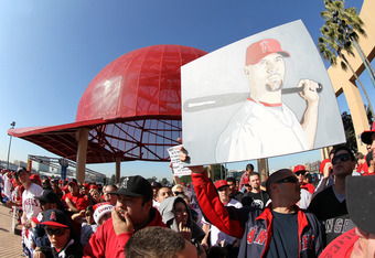 ANAHEIM, CA - DECEMBER 10: Angels fan Kyle Morrissey holds up his still unfinished painting of Albert Pujols in an Angels uniform at a public press conference introducing newly signed Los Angeles Angels of Anaheim Albert Pujols and C.J. Wilson at Angel St