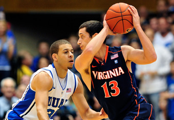DURHAM, NC - JANUARY 12:  Seth Curry #30 of the Duke Blue Devils defends Sammy Zeglinsky #13 of the Virginia Cavaliers during play at Cameron Indoor Stadium on January 12, 2012 in Durham, North Carolina.  (Photo by Grant Halverson/Getty Images)
