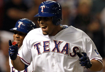 ARLINGTON, TX - OCTOBER 22:  Nelson Cruz #17 and Adrian Beltre #29 of the Texas Rangers celebrate after Cruz hits a two-run home run in the fourth inning during Game Three of the MLB World Series against the St. Louis Cardinals at Rangers Ballpark in Arli