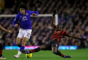 LIVERPOOL, ENGLAND - JANUARY 31:   Marouane Fellaini of Everton is challenged by Micah Richards of Manchester City during the Barclays Premier League match between Everton and Manchester City at Goodison Park on January 31, 2012 in Liverpool, England. (Ph