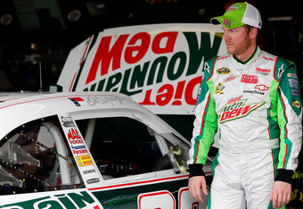 AVONDALE, AZ - NOVEMBER 11: Dale Earnhardt Jr., driver of the #88 Retro Diet Mountain Dew/National Guard Chevrolet, walks in the garage during practice for the NASCAR Sprint Cup Series Kobalt Tools 500 at Phoenix International Raceway on November 11, 2011
