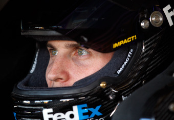 FORT WORTH, TX - NOVEMBER 04:  Denny Hamlin, driver of the #11 FedEx Office Toyota, looks on from his car in the garage during practice for the NASCAR Sprint Cup Series AAA Texas 500 at Texas Motor Speedway on November 4, 2011 in Fort Worth, Texas.  (Phot