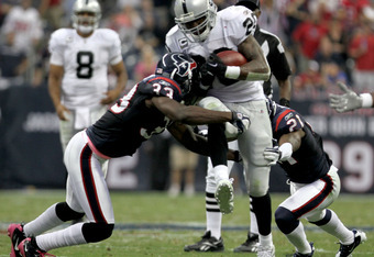 HOUSTON, TX - OCTOBER 09:  Running back Darren McFadden #20 of the Oakland Raiders rushes against the Houston Texans on October 9, 2011 at Reliant Stadium in Houston, Texas. Raiders won 25 to 20.(Photo by Thomas B. Shea/Getty Images)