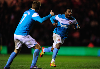 MIDDLESBROUGH, ENGLAND - FEBRUARY 08:  Sunderland player Stephane Sessegnon (r) celebrates his goal during the FA Cup Fourth Round Replay between Middlesbrough and Sunderland at Riverside Stadium on February 8, 2012 in Middlesbrough, England.  (Photo by S