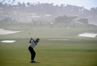 PEBBLE BEACH, CA - FEBRUARY 09:  Charlie Wi of South Korea hits his second shot on the 12th hole during the AT&T Pebble Beach National Pro-Am the Monterey Peninsula Country Club (Shore Course) on February 9, 2012 in Pebble Beach, California.  (Photo by Ha