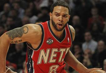 CHICAGO, IL - JANUARY 23:  Deron Williams #8 of the New Jersey Nets moves against Derrick Rose #1 of the Chicago Bulls at the United Center on January 23, 2012 in Chicago, Illinois. The Bulls defeated the Nets 110-95. NOTE TO USER: User expressly acknowle
