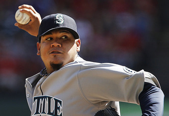 ARLINGTON, TX - SEPTEMBER 24: Starting pitcher Felix Hernandez #34 of the Seattle Mariners throws a pitch during the first inning of a baseball game against the Texas Rangers at Rangers Ballpark in Arlington on September 24, 2011 in Arlington, Texas. (Pho