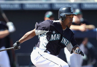 PEORIA, AZ - MARCH 12:  Chone Figgins #9 of the Seattle Mariners hits a RBI single against the Oakland Athletics during the second inning of the spring training game at Peoria Stadium on March 12, 2011 in Peoria, Arizona.  (Photo by Christian Petersen/Get