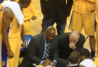 Mike Brown drawing up a play.