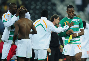 NELSPRUIT, SOUTH AFRICA - JUNE 25:  Dejected Didier Drogba of the Ivory Coast (R) after victory in the game but elimination from the tournament during the 2010 FIFA World Cup South Africa Group G match between North Korea and Ivory Coast at the Mbombela S