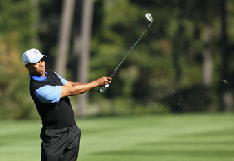 PEBBLE BEACH, CA - FEBRUARY 09: Tiger Woods hits an approach shot on the 17th hole during the first round of the AT&T Pebble Beach National Pro-Am at the Spyglass Hill Golf on February 9, 2012 in Pebble Beach, California.  (Photo by Jeff Gross/Getty Image