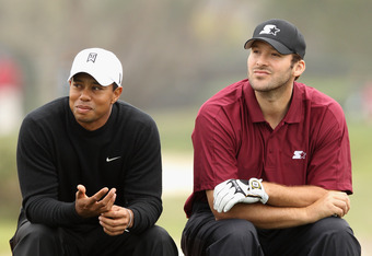 PEBBLE BEACH, CA - FEBRUARY 10:  (L-R) Tiger Woods and NFL football quarterback for the Dallas Cowboys, Tony Romo wait on the sixth tee during the second round of the AT&T Pebble Beach National Pro-Am at the Monterey Peninsula Country Club (Shore Course)