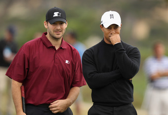PEBBLE BEACH, CA - FEBRUARY 10: (L-R) Tony Romo, NFL football quarterback for the Dallas Cowboys, talks with Tiger Woods on the ninth green after putting during the second round of the AT&T Pebble Beach National Pro-Am at the Monterey Peninsula Country Cl