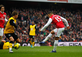 LONDON, ENGLAND - FEBRUARY 04:  Alex Oxlade-Chamberlain of Arsenal scores Arsenal's fifth goal during the Barclays Premier League match between Arsenal and Blackburn Rovers at Emirates Stadium on February 4, 2012 in London, England.  (Photo by Paul Gilham