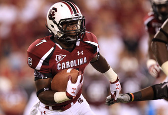 CHARLOTTE, NC - SEPTEMBER 03:  Shon Carson #7 of the South Carolina Gamecocks during their game at Bank of America Stadium on September 3, 2011 in Charlotte, North Carolina.  (Photo by Streeter Lecka/Getty Images)