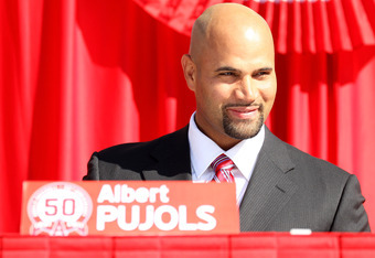 ANAHEIM, CA - DECEMBER 10:  Albert Pujols sits on the stage at a public press conference introducing newly signed Los Angeles Angels of Anaheim  players Pujols and C.J. Wilson at Angel Stadium on December 10, 2011 in Anaheim, California.  (Photo by Stephe