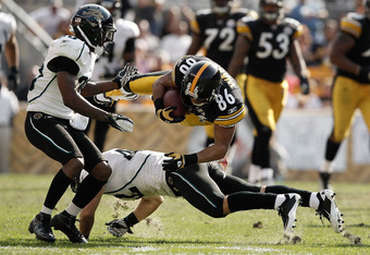 PITTSBURGH, PA - OCTOBER 16:  Hines Ward #86 of the Pittsburgh Steelers is upended by members of the Jacksonville Jaguars after catching a pass during the game on October 16, 2011 at Heinz Field in Pittsburgh, Pennsylvania.  (Photo by Jared Wickerham/Gett