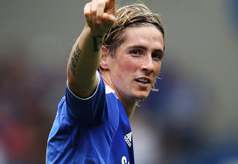 LONDON, ENGLAND - SEPTEMBER 24:  Fernando Torres of Chelsea celebrates as he scores their first goal during the Barclays Premier League match between Chelsea and Swansea City at Stamford Bridge on September 24, 2011 in London, England.  (Photo by Clive Ro
