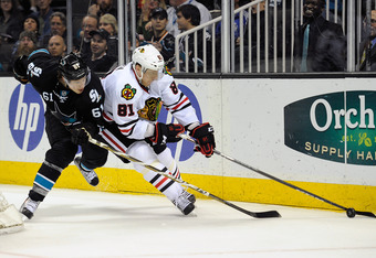 SAN JOSE, CA - FEBRUARY 10: Marian Hossa #81 of the Chicago Blackhawks controls the puck keeping it away from Justin Braun of the San Jose Sharks during an NHL hockey  game at HP Pavilion at San Jose on February 10, 2012 in San Jose, California. The Shark
