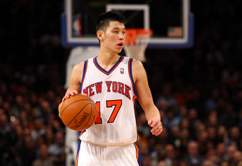 NEW YORK, NY - FEBRUARY 10:  Jeremy Lin #17 of the New York Knicks brings the ball up court against the Los Angeles Lakers at Madison Square Garden on February 10, 2012 in New York City.  NOTE TO USER: User expressly acknowledges and agrees that, by downl