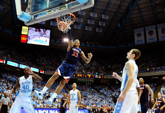 Akil Mitchell scores on a spectacular dunk for Virginia.