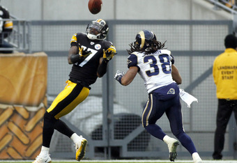 PITTSBURGH, PA - DECEMBER 24:  Mike Wallace #17 of the Pittsburgh Steelers makes a catch against  Josh Gordy #38 of the St. Louis Rams during the game on December 24, 2011 at Heinz Field in Pittsburgh, Pennsylvania.  The Steelers won 27-0.  (Photo by Just
