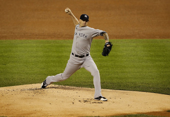 DETROIT, MI - OCTOBER 04:  A J Burnett #34 of the New York Yankees pitches in the first inning during Game Four of the American League Divison Series against the Detroit Tigers at Comerica Park on October 4, 2011 in Detroit, Michigan. The Yankees defeated