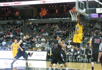 DeAndre Nealy dunks against Saint Joseph's College, Saturday.
