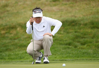 PEBBLE BEACH, CA - FEBRUARY 11:  Charlie Wi of South Korea lines up a putt on the second hole during the third round of the AT&T Pebble Beach National Pro-Am at the Spyglass Hill Golf Course on February 11, 2012 in Pebble Beach, California.  (Photo by Ezr
