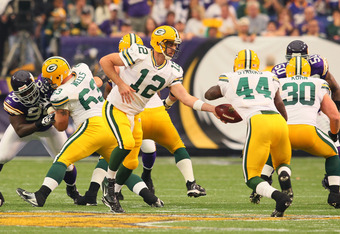 MINNEAPOLIS, MN - OCTOBER 23:  Aaron Rodgers #12 hands the ball off to James Starks #44 of the Green Bay Packers while playing against the Minnesota Vikings at the Hubert H. Humphrey Metrodome on October 23, 2011 in Minneapolis, Minnesota.  (Photo by Adam