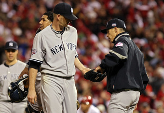 PHILADELPHIA - NOVEMBER 02:  Manager Joe Girardi (R) of the New York Yankees takes starting pitcher A.J. Burnett #34 out of the game in the bottom of the third inning against the Philadelphia Phillies in Game Five of the 2009 MLB World Series at Citizens