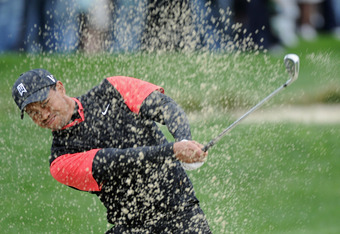 PEBBLE BEACH, CA - FEBRUARY 12:  Tiger Woods hits from a bunker on the second hole during the final round of the AT&T Pebble Beach National Pro-Am at Pebble Beach Golf Links on February 12, 2012 in Pebble Beach, California.  (Photo by Harry How/Getty Imag
