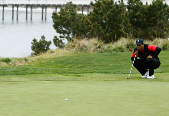 PEBBLE BEACH, CA - FEBRUARY 12:  Tiger Woods lines up his putt on the fifth hole during the final round of the AT&T Pebble Beach National Pro-Am at Pebble Beach Golf Links on February 12, 2012 in Pebble Beach, California.  (Photo by Jeff Gross/Getty Image