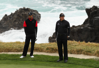 PEBBLE BEACH, CA - FEBRUARY 12: (L-R) Tiger Woods and Phil Mickelson wait on the seventh green during the final round of the AT&T Pebble Beach National Pro-Am at Pebble Beach Golf Links on February 12, 2012 in Pebble Beach, California.  (Photo by Ezra Sha