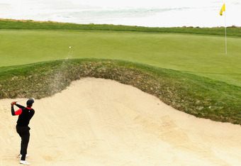 PEBBLE BEACH, CA - FEBRUARY 12:  Tiger Woods hits out of a bunker on the ninth hole during the final round of the AT&T Pebble Beach National Pro-Am at Pebble Beach Golf Links on February 12, 2012 in Pebble Beach, California.  (Photo by Ezra Shaw/Getty Ima