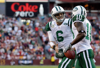 LANDOVER, MD - DECEMBER 04:  Mark Sanchez #6 of the New York Jets celebrates after throwing a touchdown pass to Santonio Holmes #10 during the second half against the Washington Redskins at FedExField on December 4, 2011 in Landover, Maryland.  (Photo by