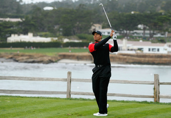 PEBBLE BEACH, CA - FEBRUARY 12:  Tiger Woods hits his tees shot on the seventh hole during the final round of the AT&T Pebble Beach National Pro-Am at Pebble Beach Golf Links on February 12, 2012 in Pebble Beach, California.  (Photo by Jeff Gross/Getty Im