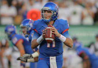 FORT COLLINS, CO - OCTOBER 15:  Quarterback Kellen Moore #11 of the Boise State Broncos delivers a pass against the Colorado State Rams at Sonny Lubick Field at Hughes Stadium on October 15, 2011 in Fort Collins, Colorado. The Broncos defeated the Rams 63