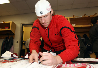 OTTAWA, ON - JANUARY 29:  Jimmy Howard #35 of the Detroit Red Wings and Team Chara signs his autograph prior to the 2012 NHL Tim Hortons NHL All-Star Game at Scotiabank Place on January 29, 2012 in Ottawa, Ontario, Canada.  (Photo by Christian Petersen/Ge