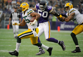 MINNEAPOLIS, MN - OCTOBER 23: Ryan Grant #25 of the Green Bay Packers carries the ball past Erin Henderson #50 of the Minnesota Vikings and Andrew Quarless #81 of the Green Bay Packers in the first quarter on October 23, 2011 at Hubert H. Humphrey Metrodo