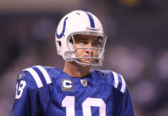 INDIANAPOLIS - NOVEMBER 28:  Peyton Manning #18 of the Indianapolis Colts watches his teammates before the NFL game against the San Diego Chargers at Lucas Oil Stadium on November 28, 2010 in Indianapolis, Indiana.  (Photo by Andy Lyons/Getty Images)