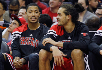 WASHINGTON, DC - JANUARY 30: Derrick Rose #1 (L) talks with teammate Joakim Noah #13 of the Chicago BuJoakim NDerrick Rose (R) during the second half against the Washington Wizards at Verizon Center on January 30, 2012 in Washington, DC. NOTE TO USER: Use