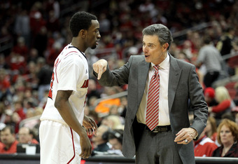 LOUISVILLE, KY - JANUARY 14:  Rick Pitino the head coach of the Louisville Cardinals gives instructions to Russ Smith #2 during the Big East Conference game against the Depaul Blue Demons at KFC YUM! Center on January 14, 2012 in Louisville, Kentucky.  Lo