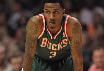 CHICAGO, IL - JANUARY 27:  Brandon Jennings #3 of the Milwaukee Bucks waits as a player for the Chicago Bulls shoots a free-throw at the United Center on January 27, 2012 in Chicago, Illinois. The Bulls defeated the Bucks 107-100. NOTE TO USER: User expre