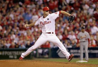 PHILADELPHIA, PA - OCTOBER 07:  Ryan Madson #46 of the Philadelphia Phillies throwsa a pitch against the St. Louis Cardinals during Game Five of the National League Divisional Series at Citizens Bank Park on October 7, 2011 in Philadelphia, Pennsylvania.