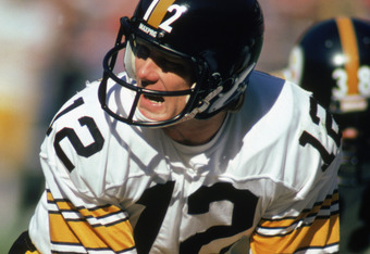 ATLANTA - NOVEMBER 1:  Quarterback Terry Bradshaw #12 of the Pittsburgh Steelers calls the play during the game against the Atlanta Falcons at Fulton County Stadium on November 1, 1981 in Atlanta, Georgia. The Steelers defeated the Falcons 34-20.  (Photo