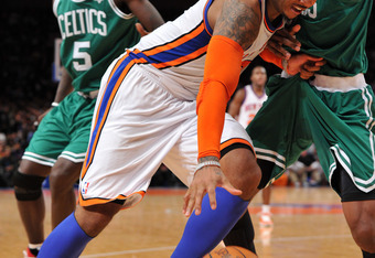 NEW YORK, NY - DECEMBER 25: Carmelo Anthony #7 of the New York Knicks drives tot he basket during the second half against the Boston Celtics at Madison Square Garden on December 25, 2011 in New York City. NOTE TO USER: User expressly acknowledges and agre