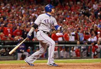 ST LOUIS, MO - OCTOBER 27:  Josh Hamilton #32 of the Texas Rangers hits a two-run home run in the 10th inning during Game Six of the MLB World Series against the St. Louis Cardinals at Busch Stadium on October 27, 2011 in St Louis, Missouri.  (Photo by Ja